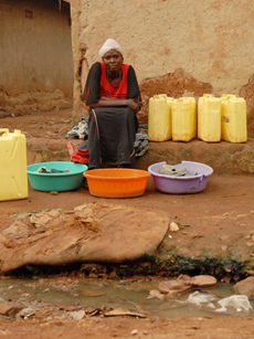 Lady Washing in Uganda